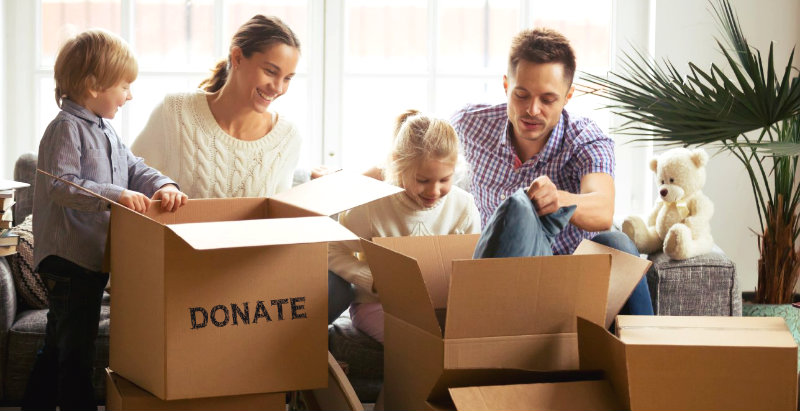 happy family of four sorting out items to donate