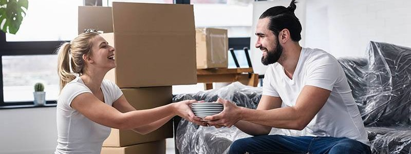 young couple packing up their house for relocation